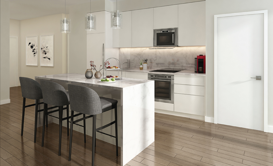 white kitchen with three barstools at island counter